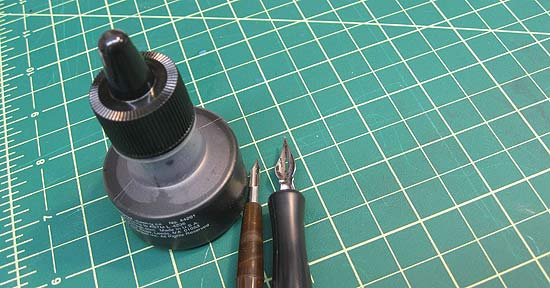Nibs, ink bottle