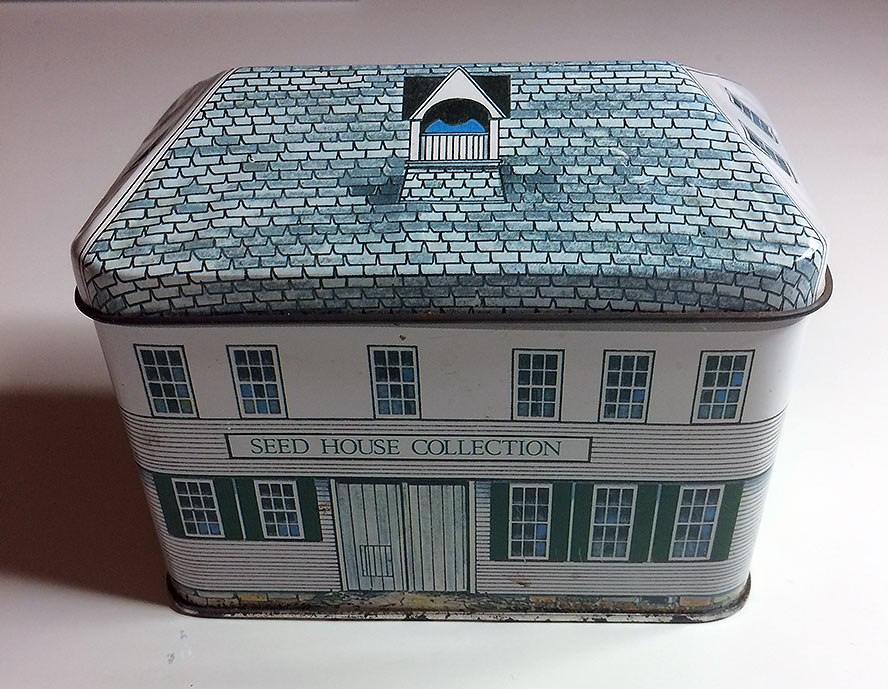 Tin box shaped like a house