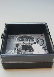 Diorama in tiny plastic box