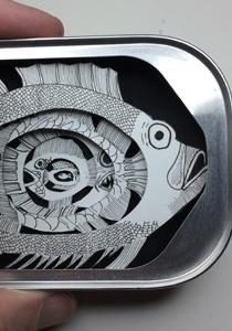 Paper fish in sardine tin