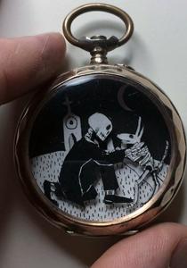 Skeleton greeting dog in a pocket watch