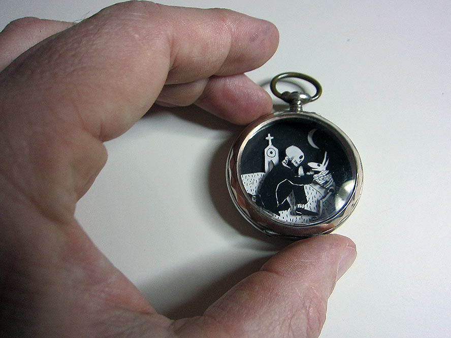 Pocket Watch with Skeleton greeting a dog