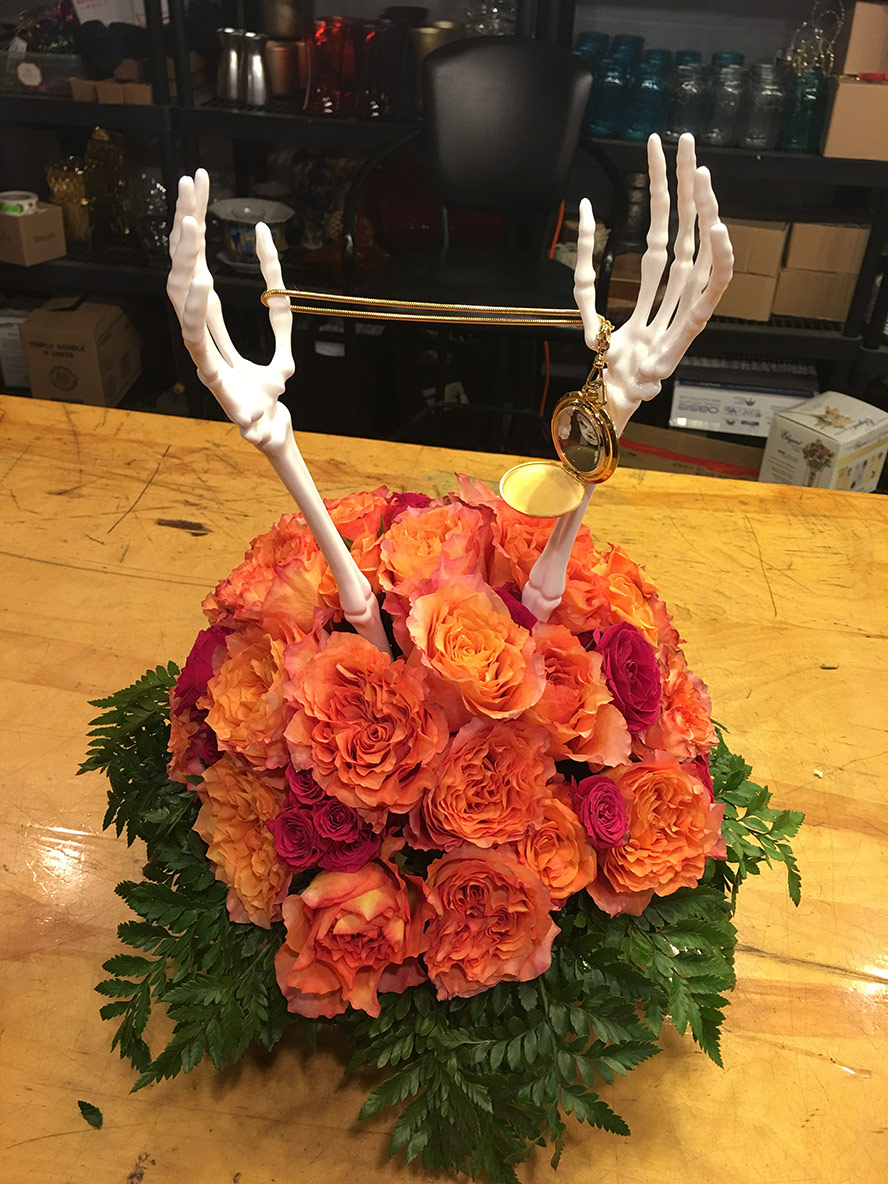 Flowers with skull hand tongs
