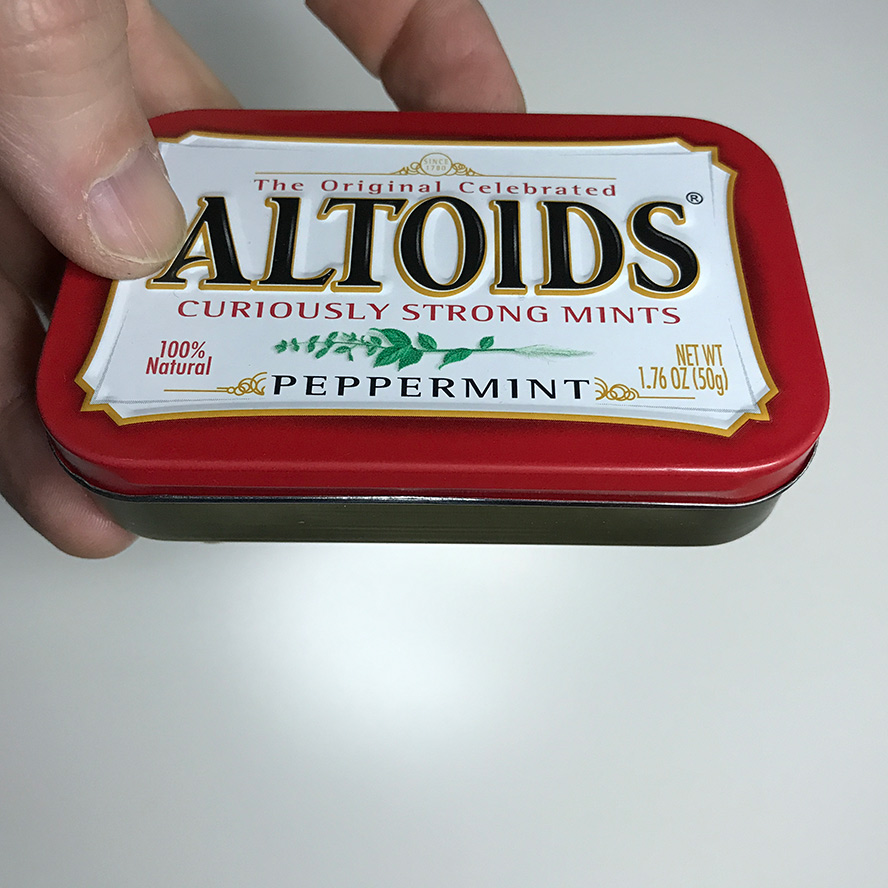 Closed Altoids tin with magic surprise inside