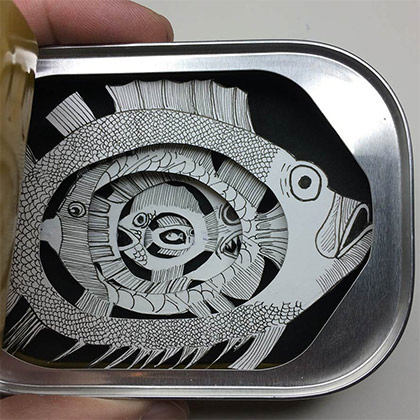 Paper fish in a real tin