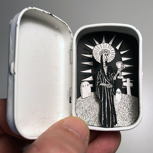 Santa Muerte in an altoids tin