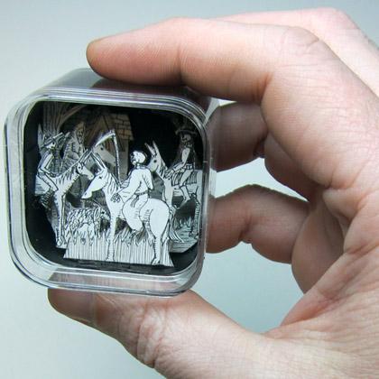 cut paper diorama in an iPod shuffle box