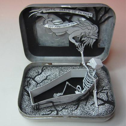 Cut paper diorama in a vintage soap tin