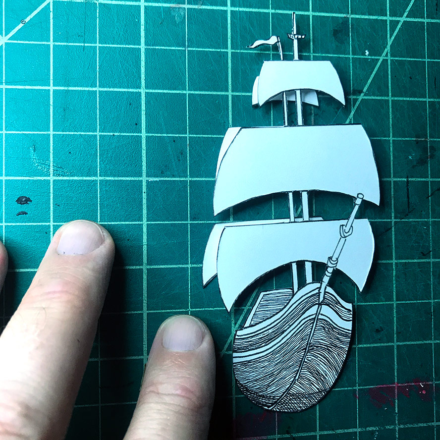 Detail of the ship and its layers, cut from paper.