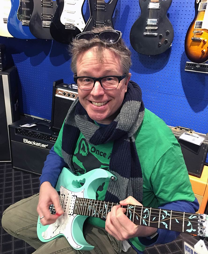 Me at guitar center playing one of Steve Vai's autographed Ibanez JEMs.