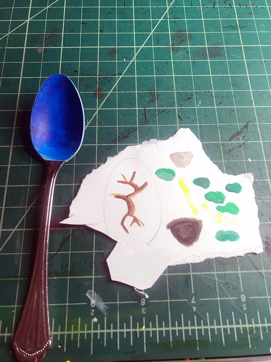 Spoon and a scrap of paper
