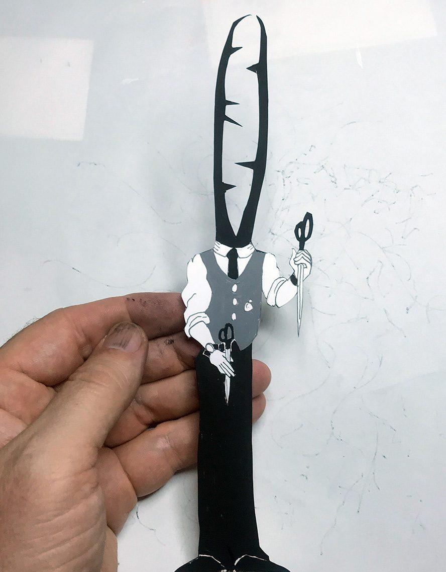 A beetle holding scissors