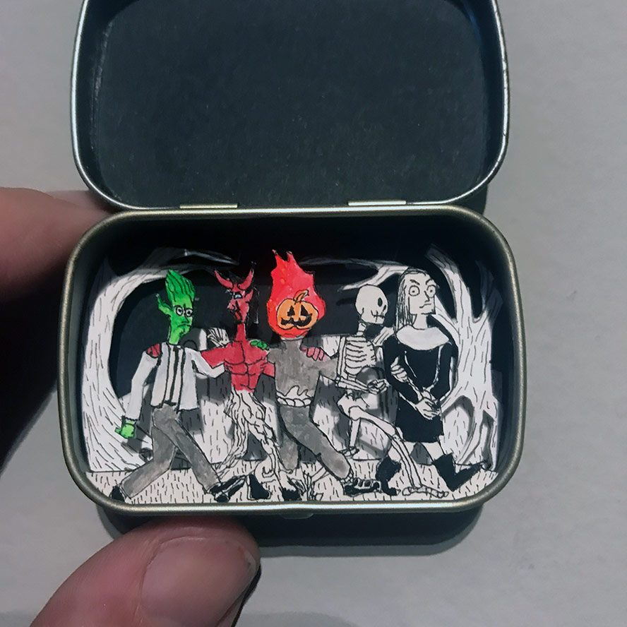 Altoids smalls with a doctor, a devil, a pumpkin head, a skeleton, and a witch.