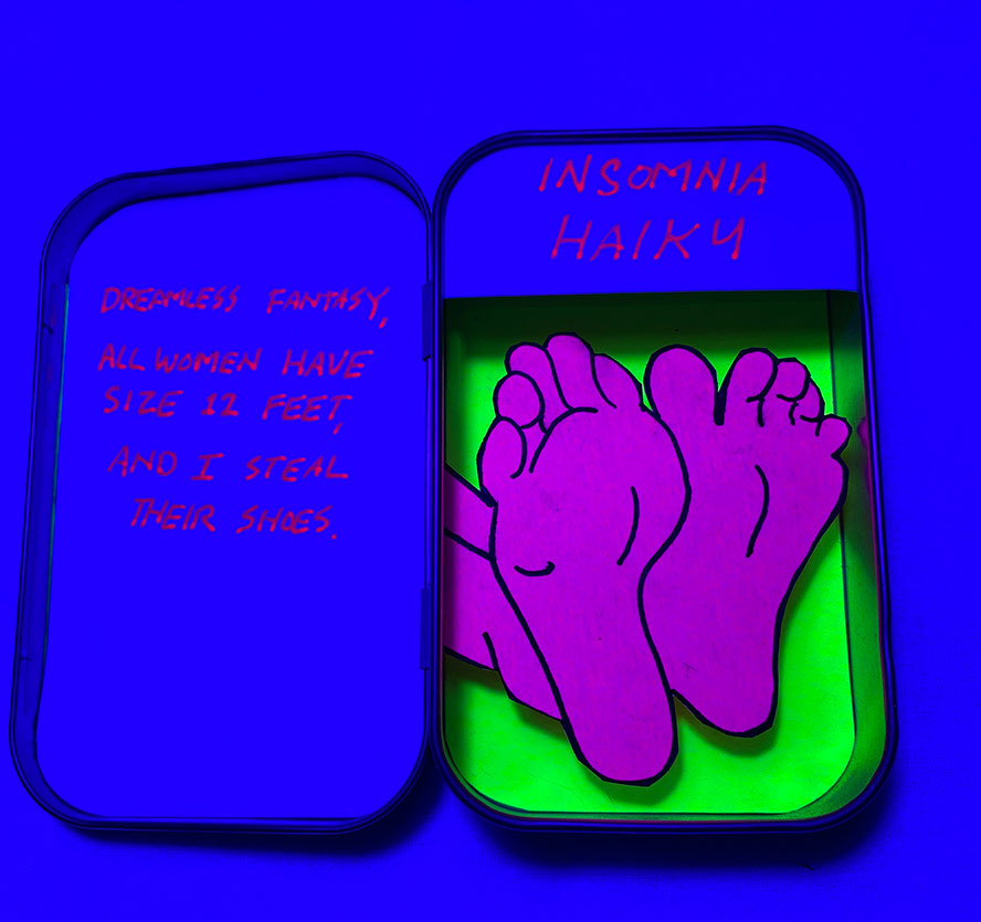 Poem in an altoids tin with the soles of feet under a black light