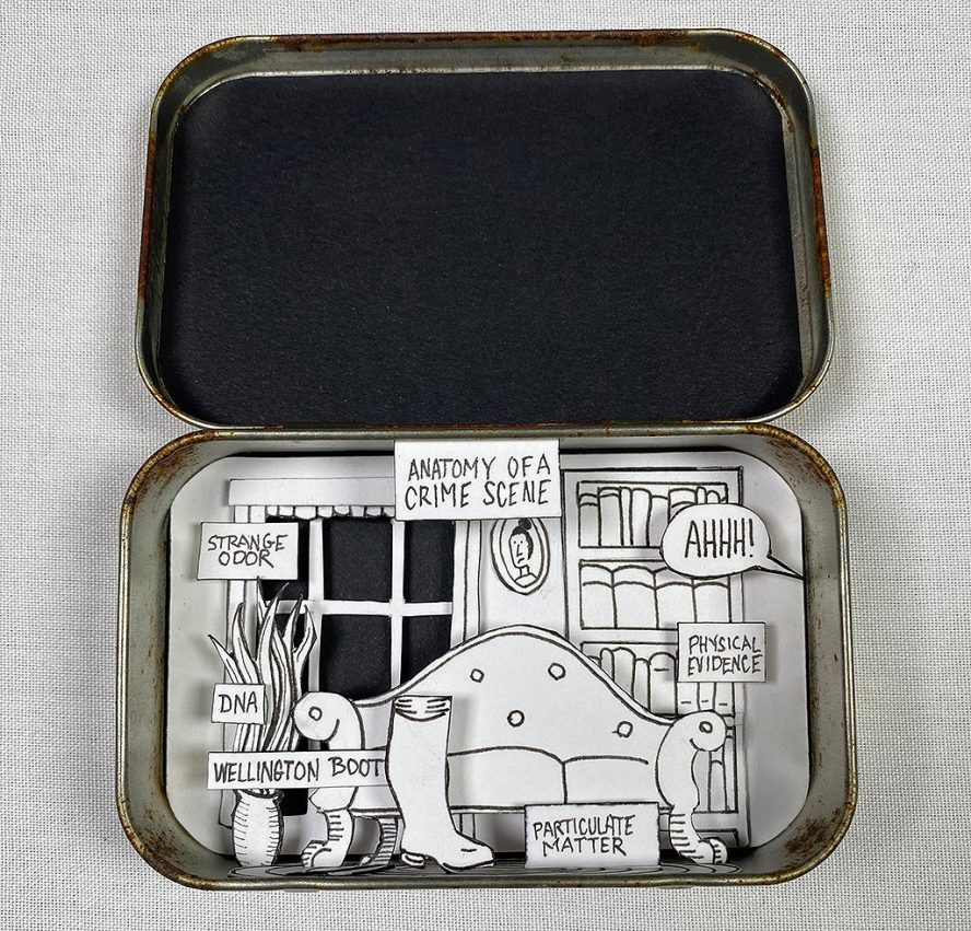 Cut paper diorama in Altoid tin showing a sitting room