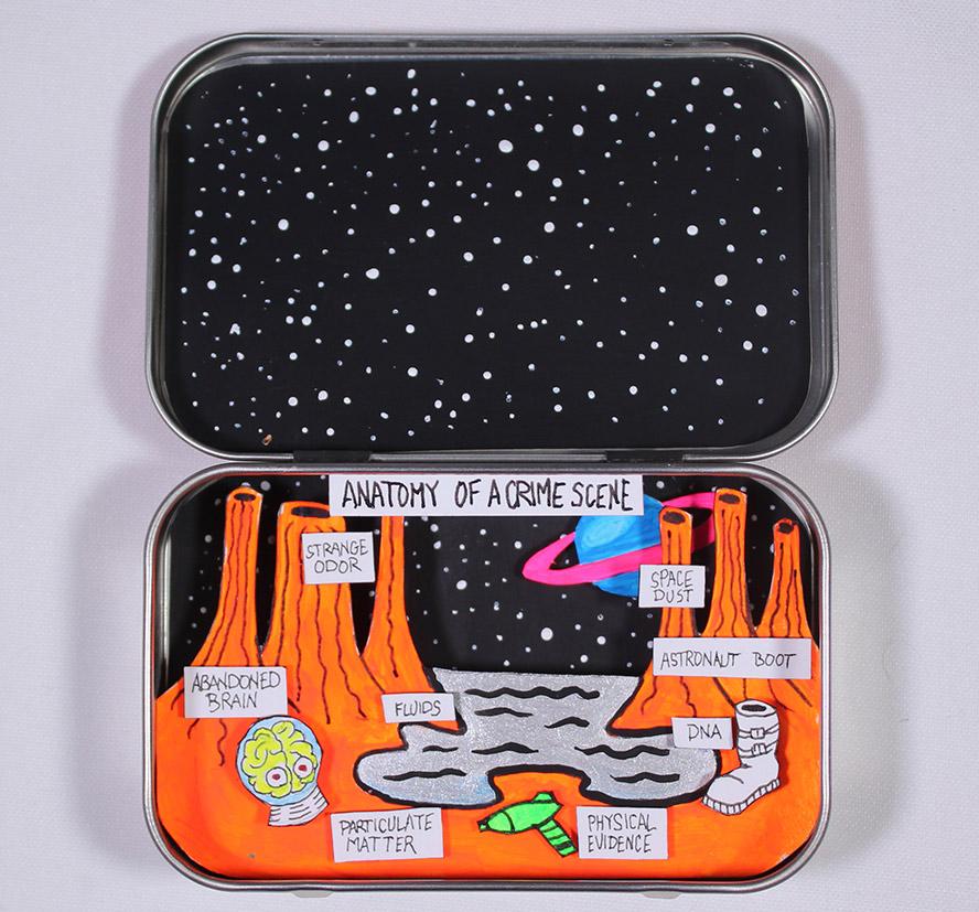 A view of an alien planet in an altoids box