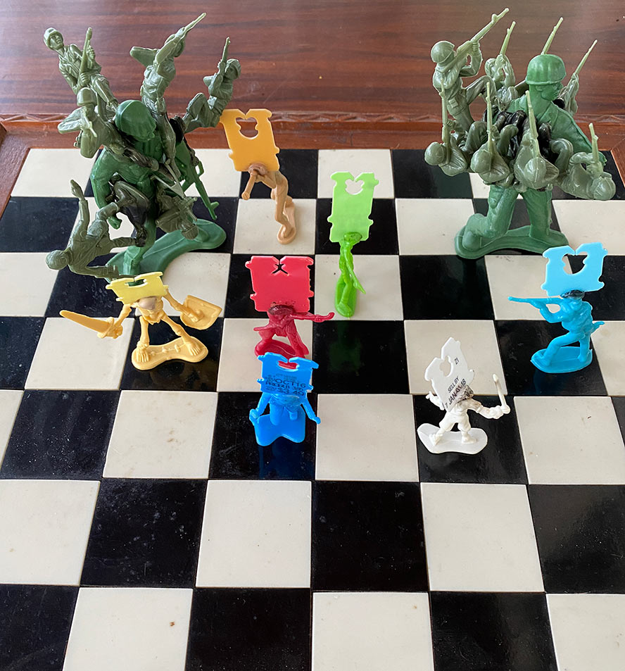Plastic figures on a chess board