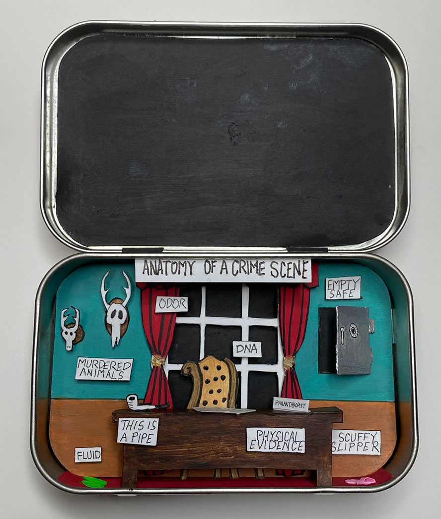 Diorama in a Altoids tin showing an office.