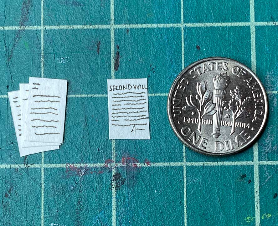 Tiny paperwork, smaller than a dime.