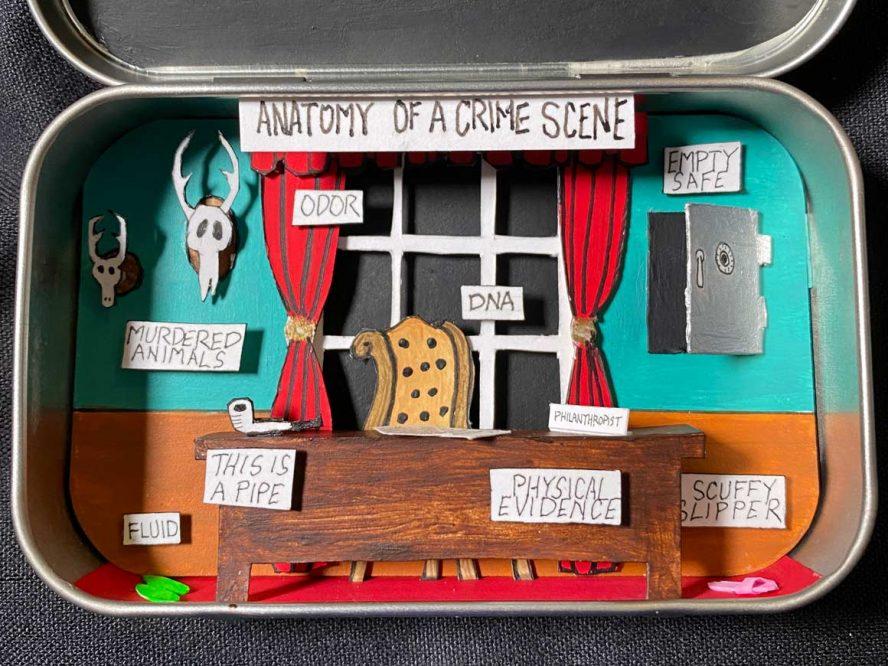 A cut paper diorama in an altoids tin