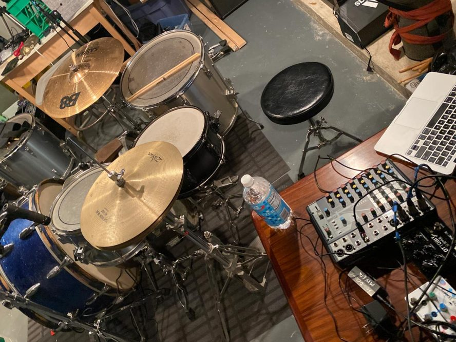 Looking down on a drum set in a basement