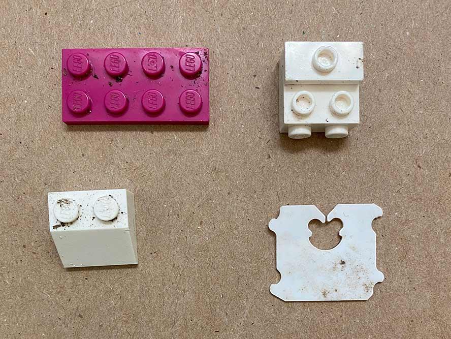 3 lego bricks and a bread tie