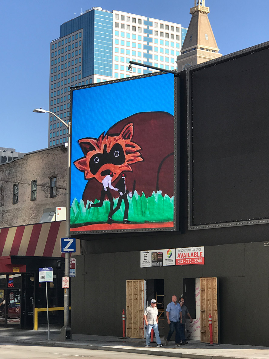 An LED screen showing a giant raccoon looking at cicada people.