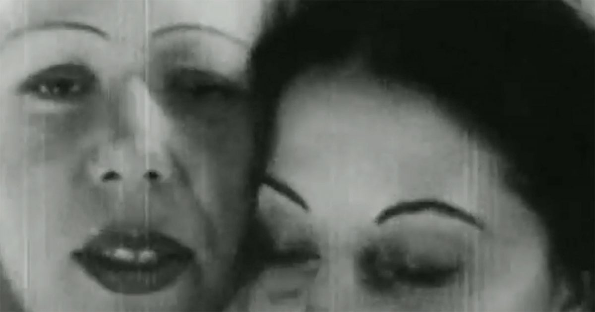 two women in black and white, faces close together